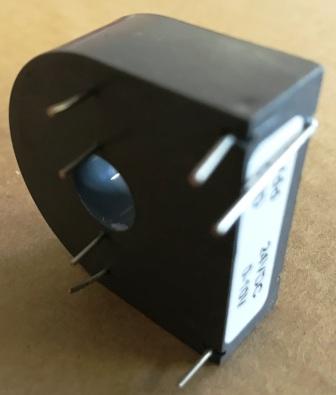 Фото 3. датчик тока ТП03 для монтажа на печатную плату с выходом 0-10в и двумя встроенными первичными обмотками